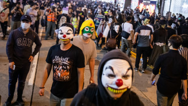 Hong Kong residents wore Halloween masks in defiance of a recent law.