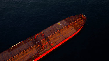 Oil tankers are seen anchored in the Pacific Ocean carrying crude oil no one will buy.