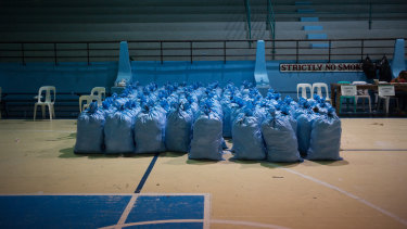 Sacks filled with relief goods sit in a gym awaiting distribution to temporary evacuation centers ahead of Mangkhut's arrival in Tuguegarao n Friday.