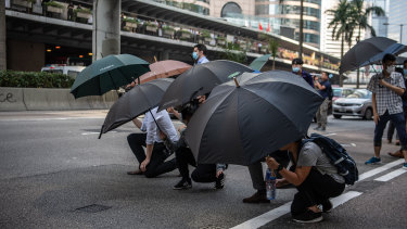 Demonstrators occupy Connaught Road Central during a protest in the Central district of Hong Kong.