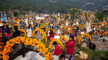 Families gather at a cemetery during Day of the Dead celebrations in the town of Cochoapa el Grande, Mexico.