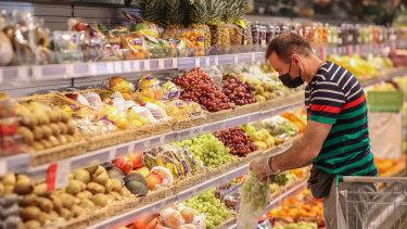 A customer shops for fresh fruit inside an Azbuka Vkusa OOO supermarket in Moscow, Russia, last week.