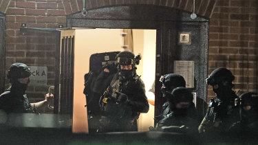 Armed police officers at a block of flats off Basingstoke Road in Reading after an incident at Forbury Gardens.