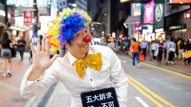 A 'Halloween' protester in a clown costume stands for a photograph in the Causeway Bay district of Hong Kong, China.