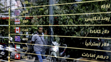 Various currencies are displayed on a money exchange bureau window in downtown Tehran.