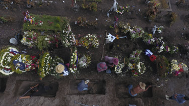 Gravediggers prepare fresh graves in a section of the Valle de Chalco Municipal Cemetery in Mexico City, which opened early in the new coronavirus pandemic to accommodate the surge in deaths.