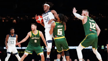 Myles Turner of the USA and Patty Mills of Australia compete for the ball during the clash at Marvel stadium.