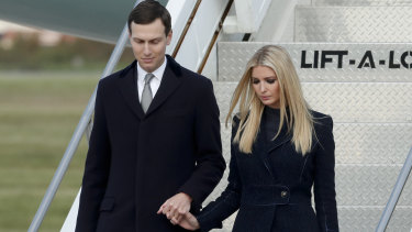 Real estate investors:  Ivanka Trump, right, departs Air Force One with husband and fellow presidential adviser Jared Kushner.