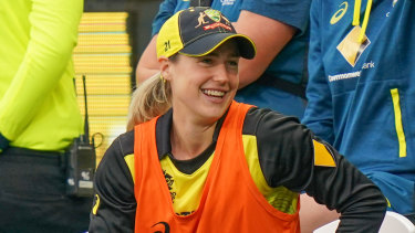 Support role: Injured Australian allrounder Ellyse Perry watched on as her side dominated.