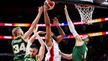 Rearguard action: Canada's Khem Birch drives to the basket.