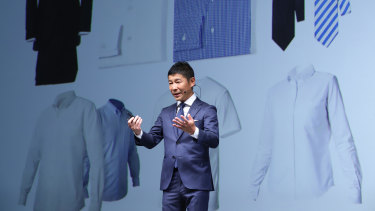 """Yusaku Maezawa with some of his basic Zozo garments: """"I want the idea of ordering bespoke online clothing to become part of the infrastructure of daily life, just like electricity, water, gas."""""""
