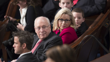 Former vice-president Dick Cheney, left, sits with his daughter, then-newly-elected Representative Liz Cheney in 2017.