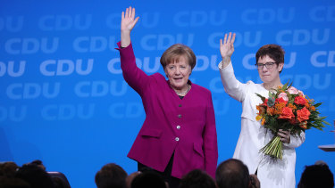 German Chancellor Angela Merkel congratulates her CDU colleague Annegret Kramp-Karrenbauer, now widely tipped as her successor.