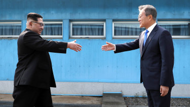 North Korean leader Kim Jong-un prepares to shake hands with South Korean President Moon Jae-in.