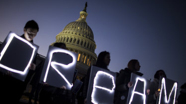 Demonstrators hold illuminated signs during a rally supporting the Deferred Action for Childhood Arrivals program (DACA), or the Dream Act, outside the US Capitol building earlier this year.