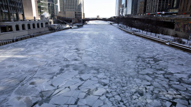 Ice floats on the Chicago River in Chicago.