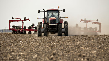 A tractor pulls a planter through a field in Illinois as corn is planted. QBE chief executive Pat Regan said many states across North America had an especially wet spring, which meant a large number of crops were not planted at all or planted late.