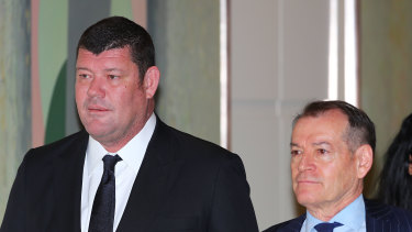 James Packer and John Alexander arrive to attend the Crown Resorts annual meeting in 2017. Both men have been called to give evidence.