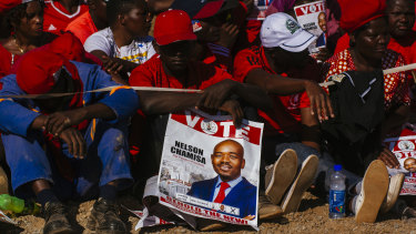 A supporter holds a placard showing Nelson Chamisa, leader of the Movement for Democratic Change (MDC), during a campaign rally in Harare, Zimbabwe, on Saturday.