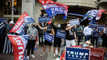 Trump supporters gather in front of the Convention Center, where votes are being counted, in Philadelphia.