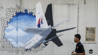 A mural for MH370. Malaysia's transport minister says the private search for the missing plane will end next week.