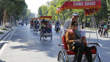 Chinese tourists ride rickshaws for sightseeing in Hanoi, Vietnam. China usually tops the list of number of tourists in Vietnam.