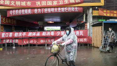 A shopper walks past a stall at a fresh produce market in Shanghai.