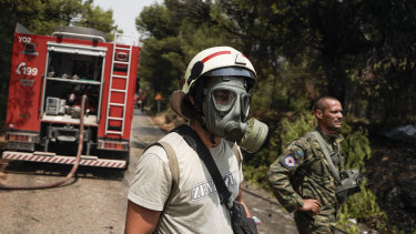 A firefighter works to contain a wildfire near Athens during a heatwave in Greece. Meanwhile, Sicily may have set a modern record for the hottest day ever in Europe on Friday, with a recorded temperature of 48.8 degrees.