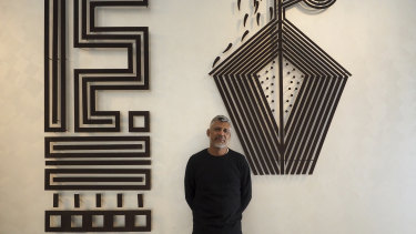 Darrell Sibosado with his work Aalingoon (Rainbow Serpent) for Tarnanthi 2019 at the Art Gallery of South Australia, Adelaide.