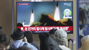 People watch a TV showing a file footage of North Korea's missile launch in Seoul on Saturday.
