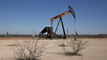 A pumpjack operates on an oil well in the Permian Basin near Crane, Texas.