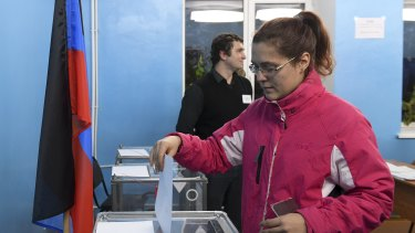 A woman casts her ballot at a polling station during rebel elections in Donetsk, Ukraine.