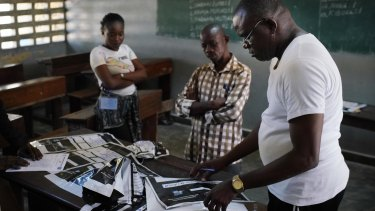 Congolese election commission officials seal the results of  elections in the St. Raphael school in the Limete district of Kinshasa, on December 3.