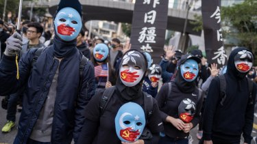 Demonstrators wear face masks during the protest.
