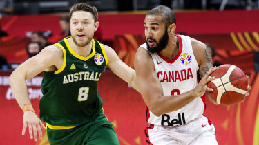Hot on the heels: Australia's Matthew Dellavedova pressures Cory Joseph of Canada during the first round match at the FIBA World Cup in China.