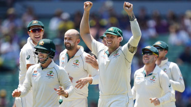 Spinning up a win: Pat Cummins, Matthew Wade, Nathan Lyon, James Pattinson and David Warner celebrate after Tim Paine stumped New Zealand's Henry Nicholls to seal a series victory for the hosts on day four of the Boxing Day Test at the MCG.