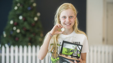 The first coin strike of 2019 is given to winner Celeste Weerts, pictured, at the Royal Australian Mint.