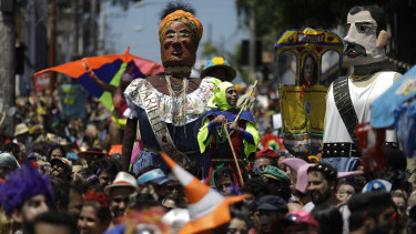 Revelers perform next to a giant puppet depicting the slain councilwoman Marielle Franco.