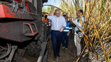 Mr Morrison during a visit with harvesting contractor Gary Stockham on a Burdekin sugar cane farm.