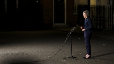 Theresa May delivers a statement outside number 10 Downing St, after surviving the leadership vote.