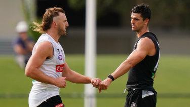 Fist bump: Lynden Dunn and Collingwood skipper Scott Pendlebury.