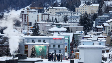 Security personnel stand on a rooftop for a briefing ahead of the World Economic Forum in Davos, Switzerland. Europeans are waiting to see if Donald Trump reprises his role as 'Tariff Man'.