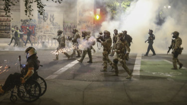 Militarised federal agents deployed by the President to Portland, Oregon, fire tear gas at protesters.