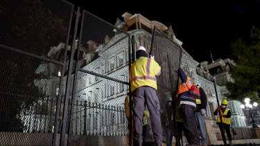 Construction workers set up additional fencing near the White House ahead of election day.