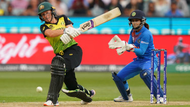 On the charge: Australian opener Alyssa Healy on her way to a rapidfire 75 off 39 balls.
