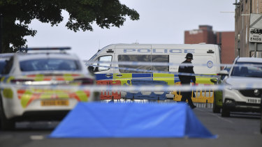 A police officer and vehicles are seen at a cordon in Irving Street in Birmingham.