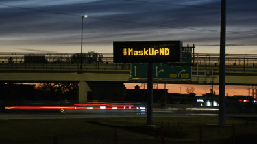 A sign in Fargo this month encouraging drivers to wear a mask. On Monday, the mayor used his emergency powers to issue a mandatory mask order.