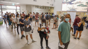 Voters wait in line to cast their vote at a polling station in Tel Aviv, Israel.