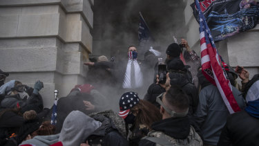 Demonstrators attempt to breach the US Capitol after they earlier stormed the building