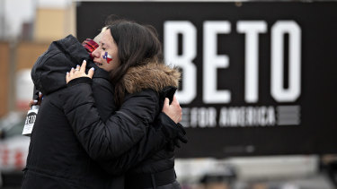Supporters of Beto O'Rourke embrace after the news.